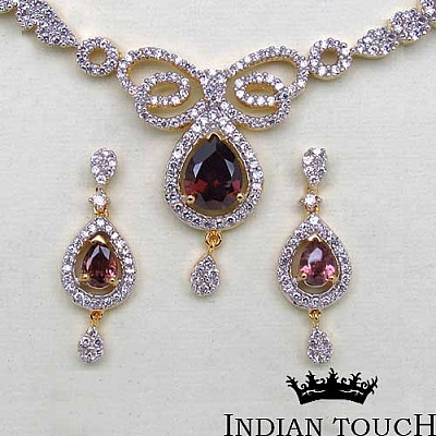 21.00 Grams Rhodolite & White Cubic Zirconia Gold Plated Bra